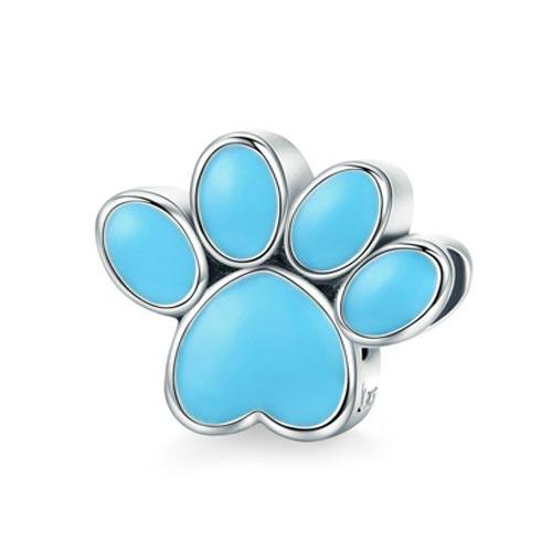 Charm Empreinte de Patte, d'un bleu éclatant, symbole de bonne humeur, qui vous rappellera à coup sûr votre petit protégé à quatre pattes